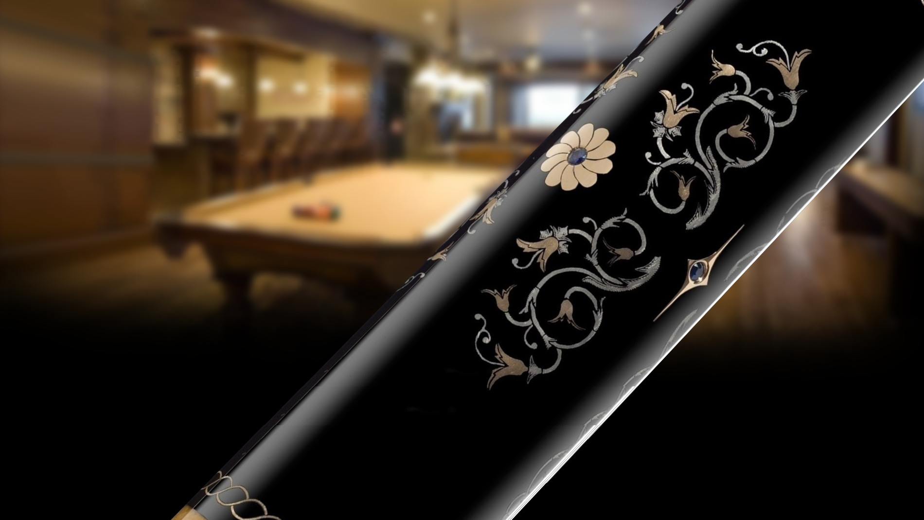 Close-up of the Silver Knights cue with billiard room background.